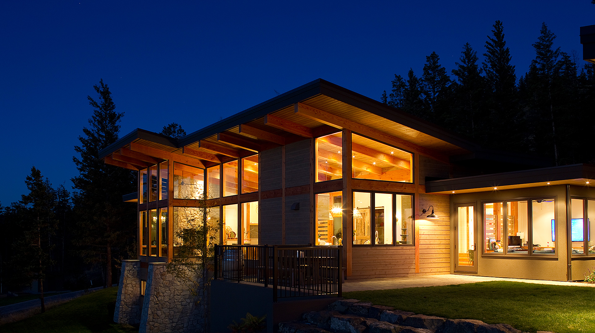Contemporary timber frame residence at night